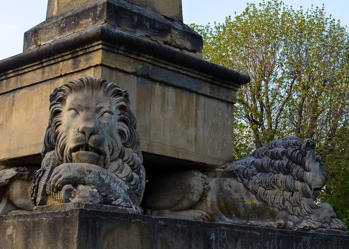 Obelisk with lions